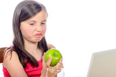 A little girl does not like apples Stock Photos
