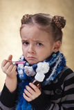 Little girl does not like cough syrup Royalty Free Stock Photography