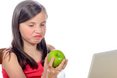 A little girl does not want apples Stock Images