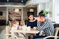 Little girl doesn`t want to hear arguing of parents Stock Photos
