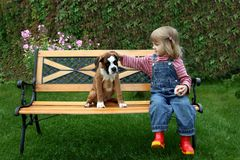 The little girl with a dog. The little girl embraces the dog Royalty Free Stock Image