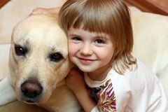The little girl with a dog. The little girl embraces the dog Stock Photography