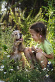 Little girl and dog Royalty Free Stock Photos
