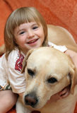 The little girl with a dog Royalty Free Stock Image