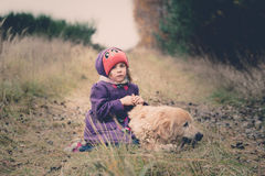 Little girl with a dog Stock Images