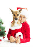 Little girl and dog in Christmas costume Stock Photography