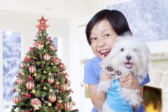 Little girl and dog with christmas tree at home Royalty Free Stock Photos