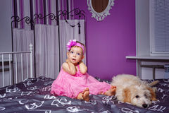 Little girl and dog Stock Image