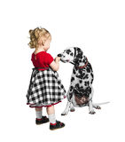 Little girl and a dog dalmatian Royalty Free Stock Photography