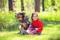 Little girl with dog Royalty Free Stock Photography