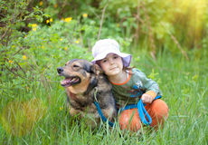 Little girl with dog Royalty Free Stock Photos