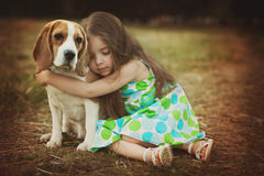 Little girl with dog. Little girl is holding dog outdoors royalty free stock images
