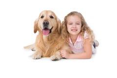 Little girl and dog lying on the floor Stock Photography