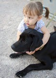 Little girl with a dog outdoors Royalty Free Stock Image