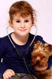Little girl with a dog Stock Image
