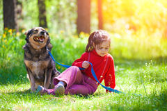 Little girl with dog Royalty Free Stock Images