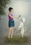 The little girl and the dog Stock Photos