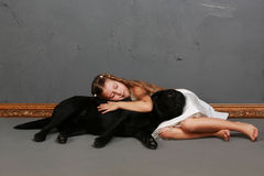 Little girl and dog in the studio Royalty Free Stock Photography