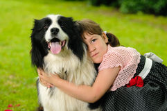 Little girl with dog. Vintage dressed little girl with border collie Stock Images