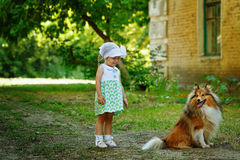 Little girl and dog for a walk. Stock Images