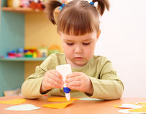 Little girl doing arts and crafts in preschool. Cute little girl doing arts and crafts in preschool royalty free stock photography