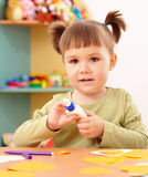 Little girl doing arts and crafts in preschool. Cute little girl doing arts and crafts in preschool Stock Photos