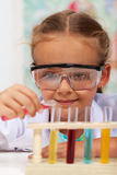 Little girl doing basic chemistry experiments Stock Photography