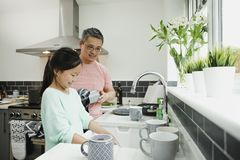 Helping Dad with the Dishes royalty free stock photography
