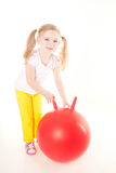Little girl doing exercise with ball. Cute sly little girl doing gymnastic exercise with ball Stock Image