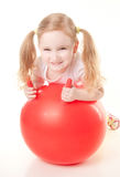 Little girl doing exercise with ball Royalty Free Stock Photos
