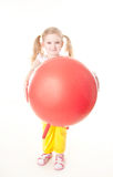 Little girl doing exercise with ball. Cute sly little girl doing gymnastic exercise with ball Stock Photography