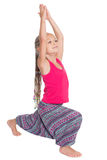 Little girl doing exercises of yoga Stock Image