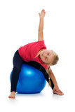 Little girl doing fitness exercise with gym ball. Royalty Free Stock Photography