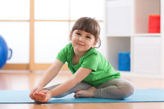 Little girl doing fitness exercises Stock Photography