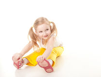 Little girl doing gymnastic exercise. Cute sly little girl doing gymnastic exercise Royalty Free Stock Image