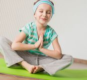 Little girl doing gymnastic exercises Stock Photos