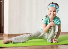 Little girl doing gymnastic exercises Stock Photo