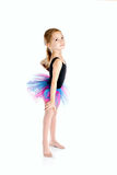 Little girl doing gymnastic exercises on a yoga mat. doing fitne Stock Photos