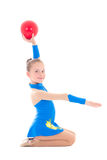 Little girl doing gymnastics with ball  isolated on white Stock Images