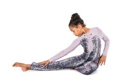 Little girl doing gymnastics Stock Photos