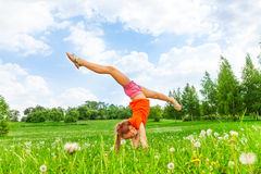 Little girl doing gymnastics on grass Stock Photography