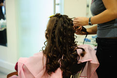 The little girl doing a hairdress Royalty Free Stock Photo