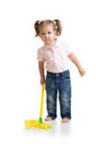 Little girl doing her chore of mopping the floor Stock Photos
