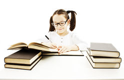 Little girl doing her homework. Stock Photo