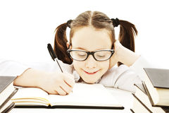 Little girl doing her homework. Royalty Free Stock Images
