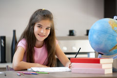 Little girl doing her homework Royalty Free Stock Photos