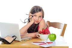 A little girl doing her homework on her computer Stock Photo