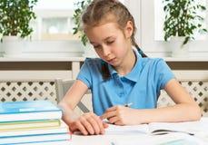 Girl doing her homework. Stock Photos