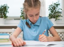 Little girl doing homework. Stock Photo