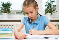 Little girl doing homework. Stock Photography